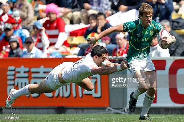 William Small-Smith of South Africa runs past Chris Brightwell of England in the Cup Quarter Final match between England and South Africa during day...