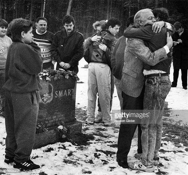 William Smart hugs a relative at the grave of his son Gregory Smart at the Forest Hill Cemetery in East Derry NH after his daughterinlaw Pamela Smart...
