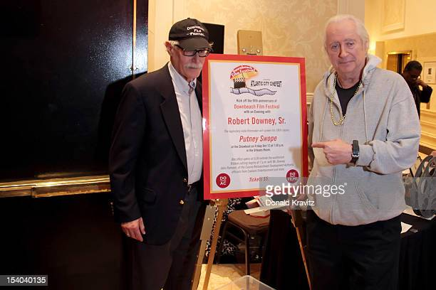 William Sokolic President of Cinefest and Robert Downey Sr stands next to his welcome sign as he attends An Evening With Robert Downey Sr during the...