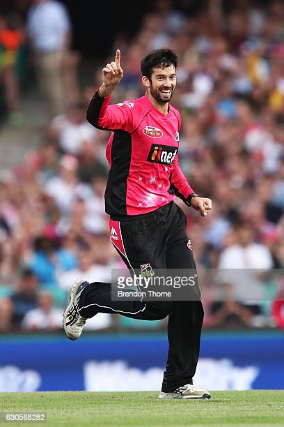 William Somerville of the Sixers celebrates after claiming the wicket of Michael Klinger of the Scorchers during the Big Bash League match between...