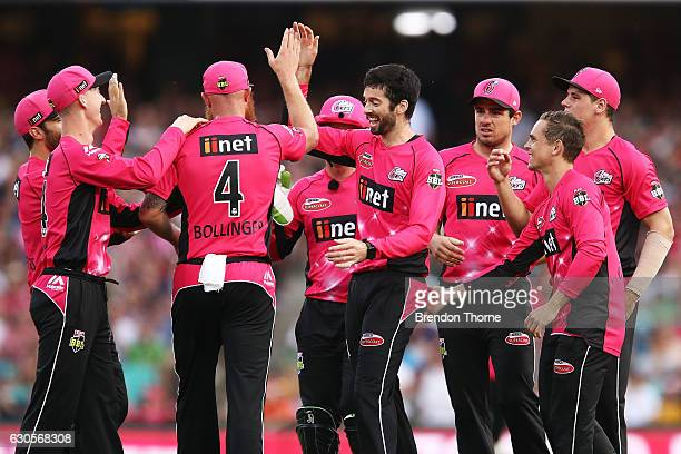 William Somerville of the Sixers celebrates with team mates after claiming the wicket of Michael Klinger of the Scorchers during the Big Bash League...