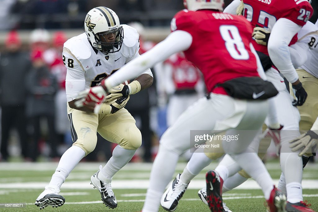 William Stanback #28 of the Central Florida Knights carries the ball against the SMU Mustangs on December 7, 2013 at Gerald J. Ford Stadium in Dallas, Texas.