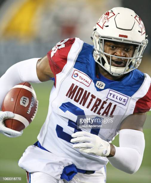 William Stanback of the Montreal Alouettes runs the ball against the Hamilton TigerCats in a CFL game at Tim Hortons Field on November 3 2018 in...
