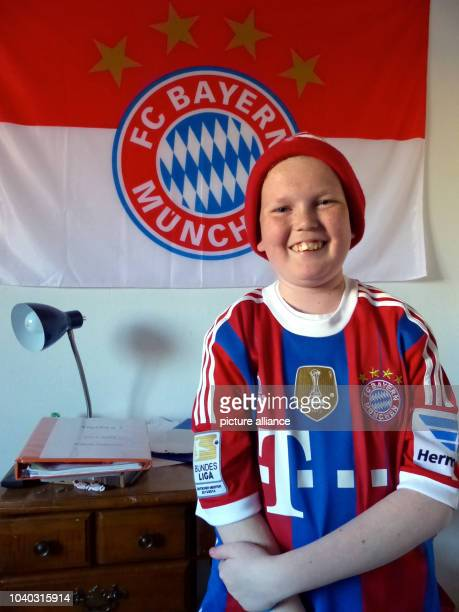 William Stuhlreyer wears an FC Bayern tricot in front of the team's flag at his home in Alameda California in March as he prepares to fulfill his...
