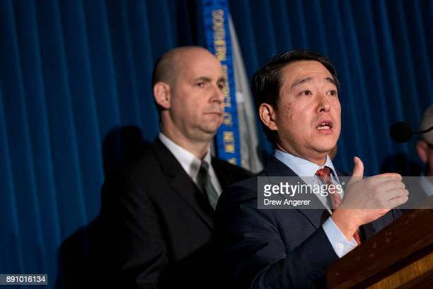 William Sweeney assistant directorincharge of the New York office of the Federal Bureau of Investigation looks on as Joon Kim acting US attorney for...