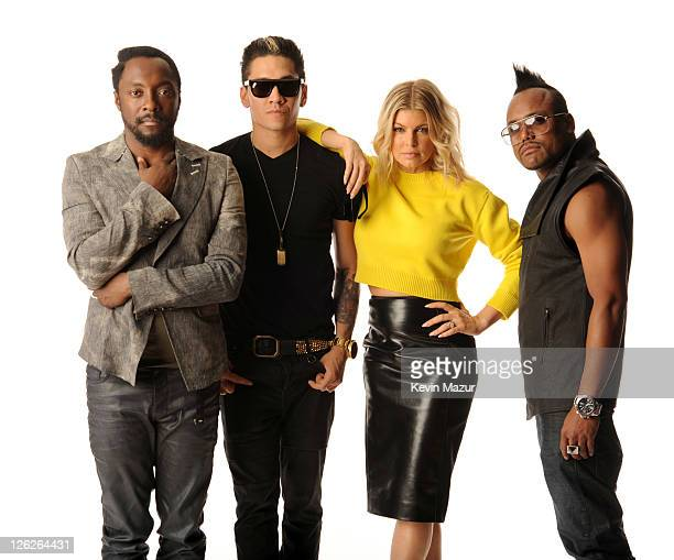 william Taboo Fergie and apldeap of Black Eyed Peas pose in the portrait studio at the iHeartRadio Music Festival held at the MGM Grand Garden Arena...