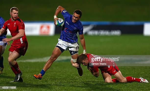 William Talataina Mu of Samoa makes a break during the 2014 Junior World Championship match between Wales and Samoa at QBE Stadium Auckland on June...