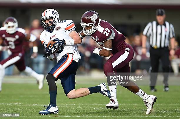 William Tanner of the Tennessee Martin Skyhawks catches a pass in front of Matthew Wells of the Mississippi State Bulldogs during the second quarter...