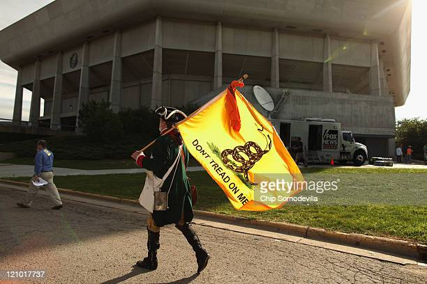 "William Temple of Brunswick, Georgia dresses in American revolutionary clothing and carries a ""Don't Tread On Me"" flag outside the Hilton Coliseum,..."