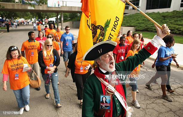 William Temple of Brunswick Georgia dresses in American revolutionary clothing and carries a Don't Tread On Me flag while marching with supporters of...