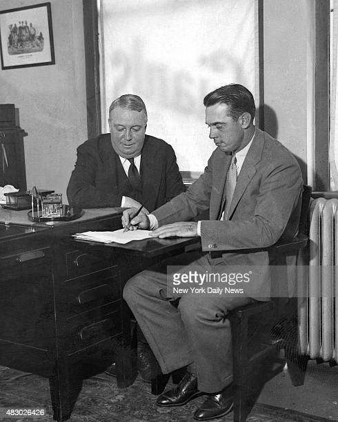 William Terry places his valuable autograph on a document profferred him by Charles Stoneham president of the Giants The paper called for Terry's...