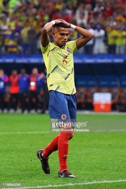 William Tesillo of Colombia reacts after missing during the penalty shoot-out following the Copa America Brazil 2019 quarterfinal match between...