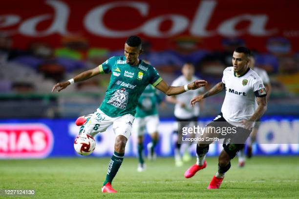 William Tesillo of Leon competes for the ball with Dario Lezcano of FC Juarez during a match between Leon and FC Juarez as part of the friendly...