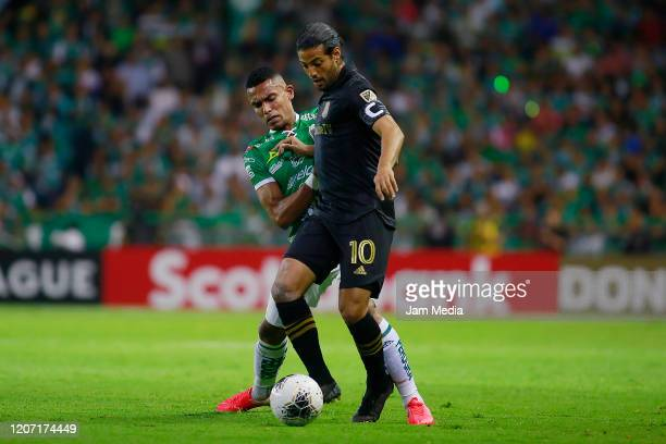 William Tesillo of Leon fights for the ball with Carlos Vela of Los Angeles during the round of 16 match between Leon and LAFC as part of the...