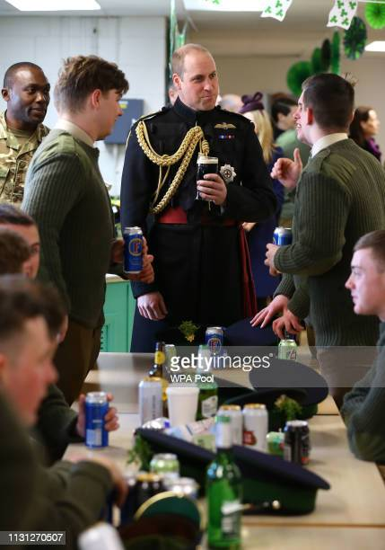 William The Duke of Cambridge meets with Irish Guards after attending the St Patrick's Day parade at Cavalry Barracks in Hounslow where he presented...
