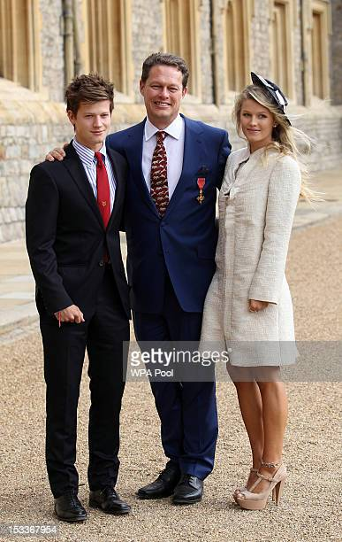 William Travers with his son Will and daughter Lily after he received his Officer of the British Empire medal from the Princess Royal during an...