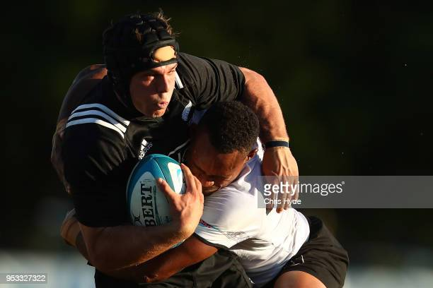 William Tremain of New Zealand is tackled during the 2018 Oceania Rugby U20 Championship match between New Zealand and Fiji at Bond University on May...