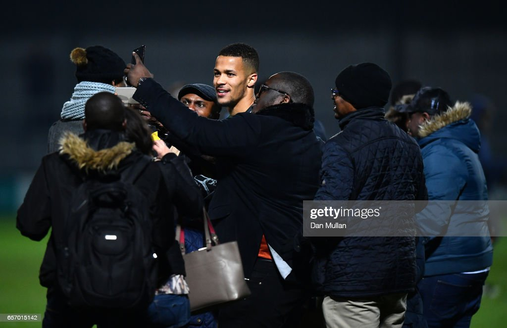 William Troost-Ekong of Nigeria is mobbed by fans on the pitch following the final whistle during the International Friendly match between Nigeria and Senegal at The Hive on March 23, 2017 in Barnet, England.