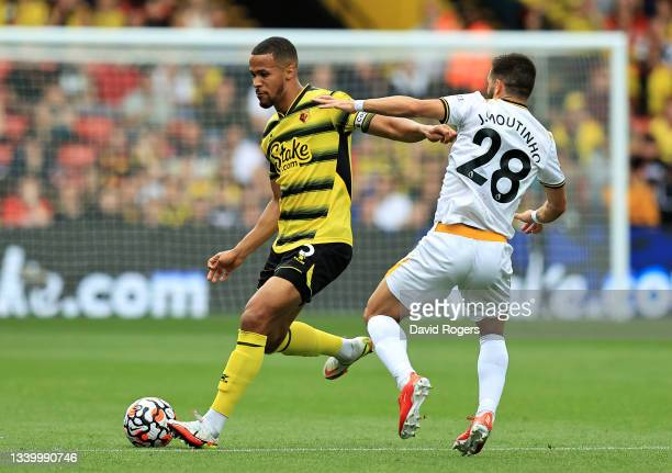 William Troost-Ekong of Watford passes the ball as Joao Moutinho challenges during the Premier League match between Watford and Wolverhampton...