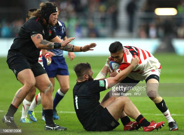 William Tupou of Japan is tackled by Alec Hepburn of England during the Quilter International match between England and Japan at Twickenham Stadium...