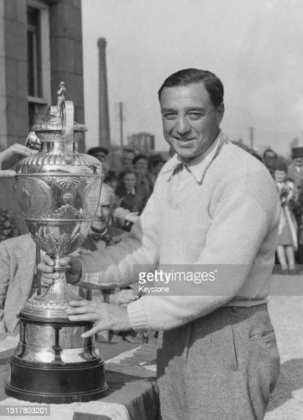 William Turnesa of the United States is presented with the Championship Trophy after winning the Amateur Golf Championship golf tournament on 1st...