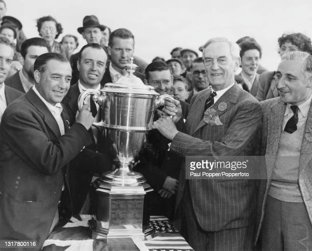 William Turnesa of the United States is presented with the Walker Cup Trophy by HF Simpson, captain of Royal Birkdale Golf Club after winning the...