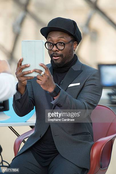 william using a Tablet at Musee du Louvre on April 12 2016 in Paris France
