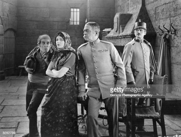 William V Mong Barbara La Marr Robert Edeson and Wallace MacDonald in a scene from the MGM production 'Thy Name Is Woman' Title Thy Name Is Woman...