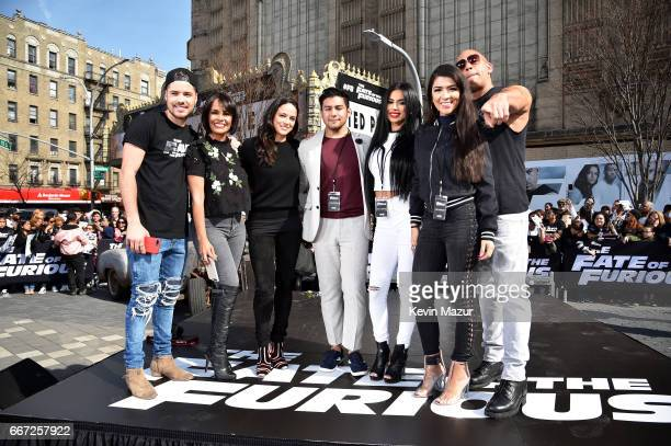 William Valdes Birmania Rios Carolina Enamorado and Sherry Maldonado pose with Michelle Rodriguez and Vin Diesel as they visit Washington Heights on...
