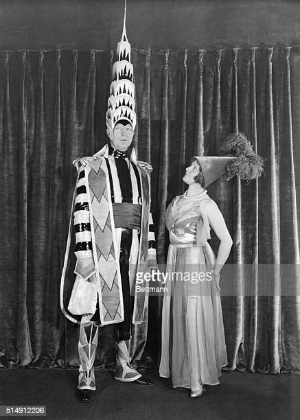 William Van Alen designer of the Chrysler Building attends the Beaux Arts Ball at the Hotel Astor with his wife dressed as a court jester with a...