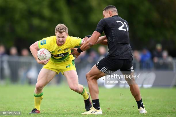 William Warbrick of the All Blacks Sevens tackles Henry Hutchinson of Australia during the International Sevens Trans-Tasman Series match between the...