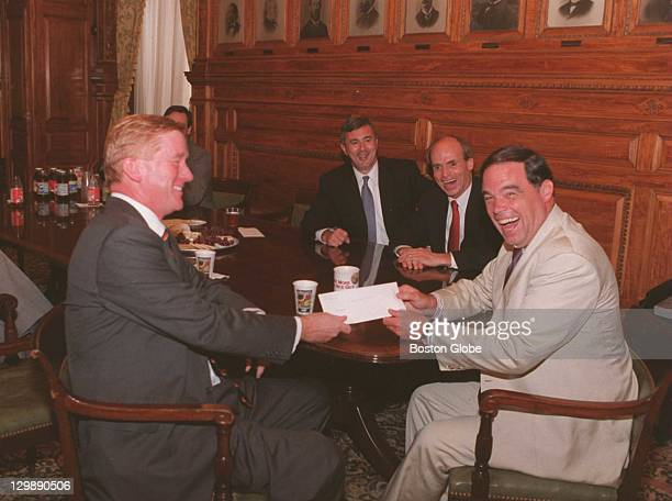 William Weld at the moment of his resignation with Lt Governor Paul Cellucci House Speaker Thomas Finneran and Senate President Thomas Birmingham