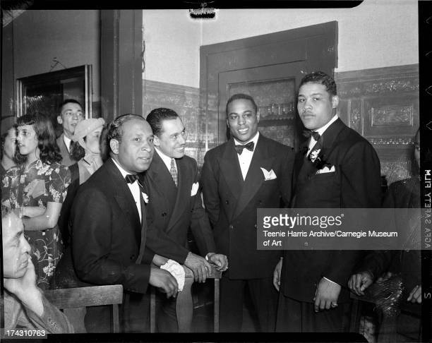William 'Woogie' Harris Cab Calloway John Henry Lewis and Joe Louis with Geraldine or Philistine Bobo at left in Loendi Club Pittsburgh Pennsylvania...