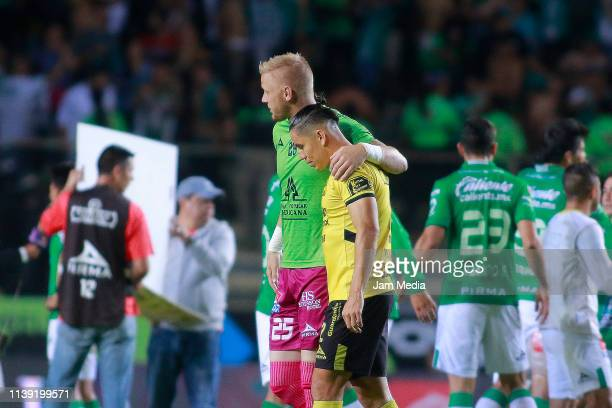 William Yarbrough Goalkeeper of Leon and Efrain Velarde of Morelia embrace after the 12th round match between Morelia and Leon as part of the Torneo...
