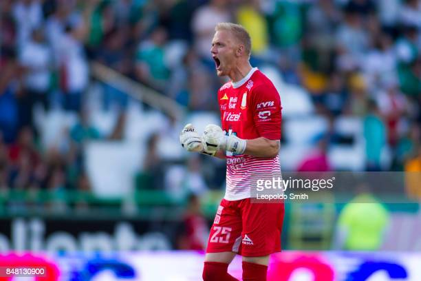 William Yarbrough of Leon celebrates celebrates the first goal of his team scored by his teammate Mauro Boselli during the 9th round match between...
