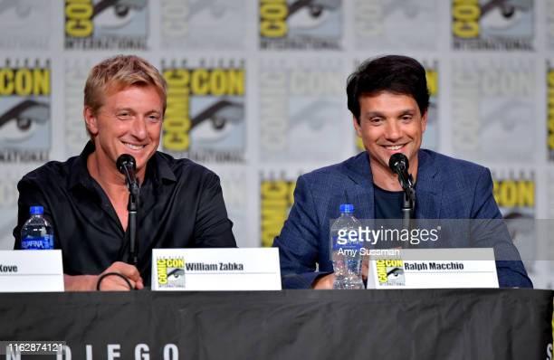 "William Zabka and Ralph Macchio speak at the ""Cobra Kai: Past, Present, And Future"" panel during 2019 Comic-Con International at San Diego Convention..."