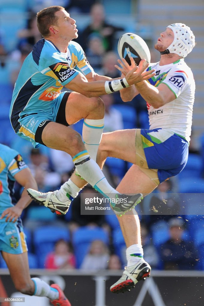 William Zillman of the Titans and Jarrod Croker of the Raiders compete for the ball during the round 18 NRL match between the Gold Coast Titans and the Canberra Raiders at Cbus Super Stadium on July 13, 2014 on the Gold Coast, Australia.