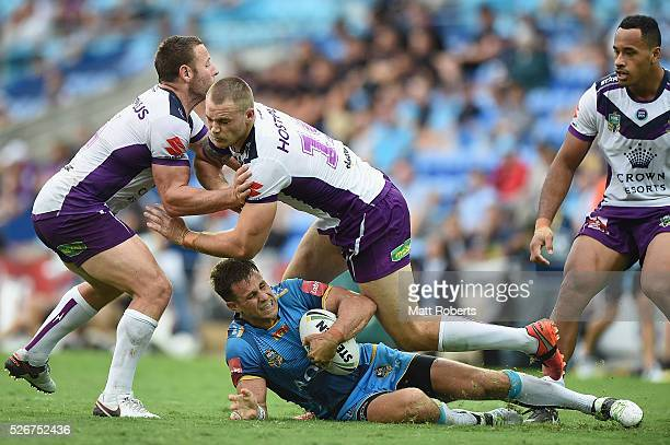 William Zillman of the Titans is tackled during the round nine NRL match between the Gold Coast Titans and the Melbourne Storm on May 1 2016 in Gold...