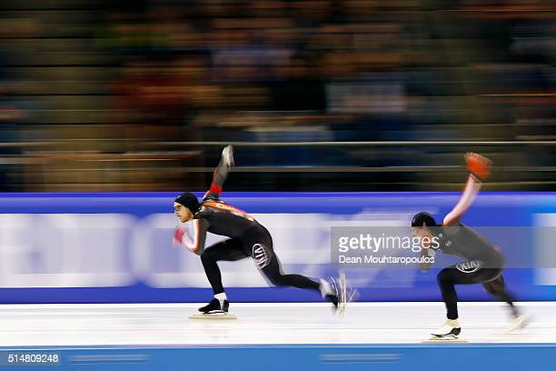 William Dutton and Laurent Dubreuil both of Canada compete in the Men 500m race during day one of the ISU World Cup Speed Skating Finals held at...