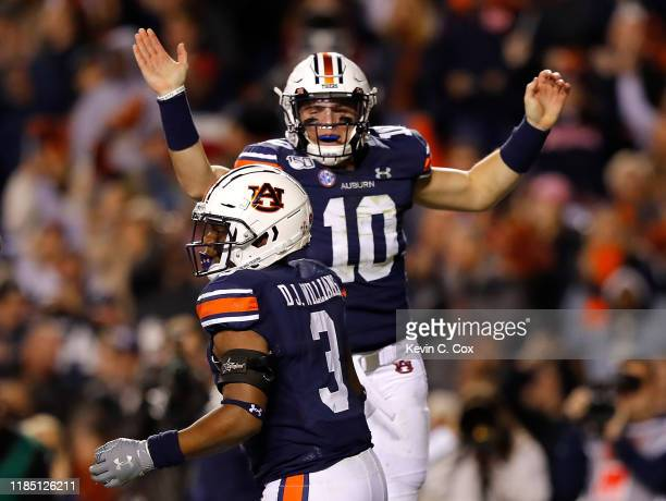 J Williams and Bo Nix of the Auburn Tigers celebrate Williams' rushing touchdown in the first half against the Mississippi Rebels at JordanHare...