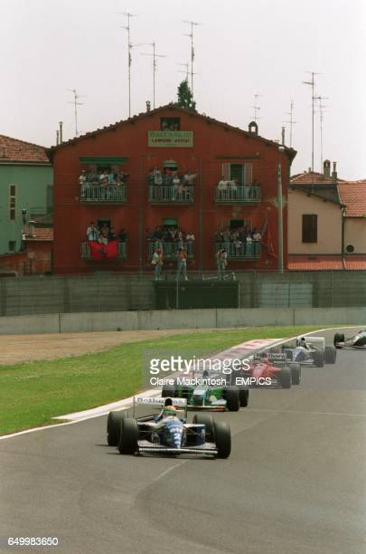 Williams' Ayrton Senna leads the slow parade behind the safety car