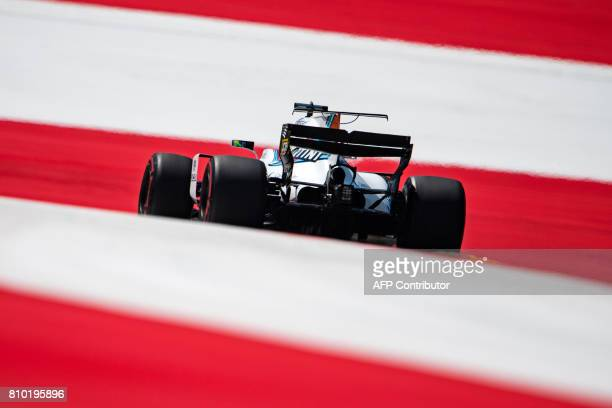 TOPSHOT Williams' Brazilian driver Felipe Massa drives his car during the first practice session of the Formula One Austria Grand Prix at the Red...