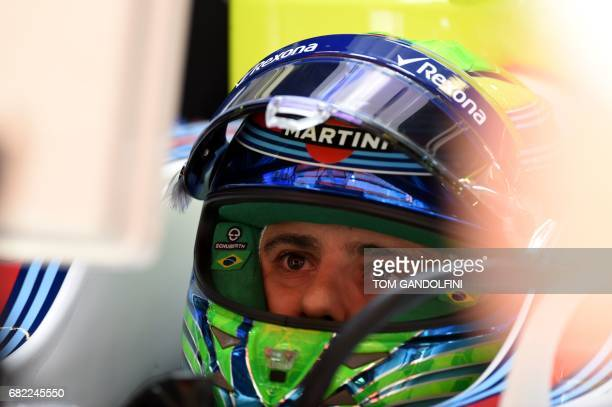Williams' Brazilian driver Felipe Massa looks at a screen in the pits during the first practice session at the Circuit de Catalunya on May 12 2017 in...
