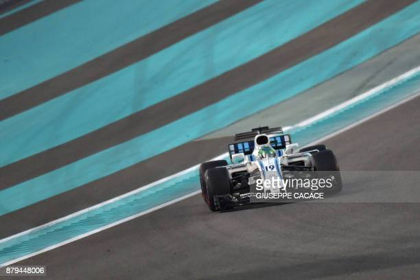Williams' Brazilian driver Felipe Massa steers his car during the Abu Dhabi Formula One Grand Prix at the Yas Marina circuit on November 26 2017 /...