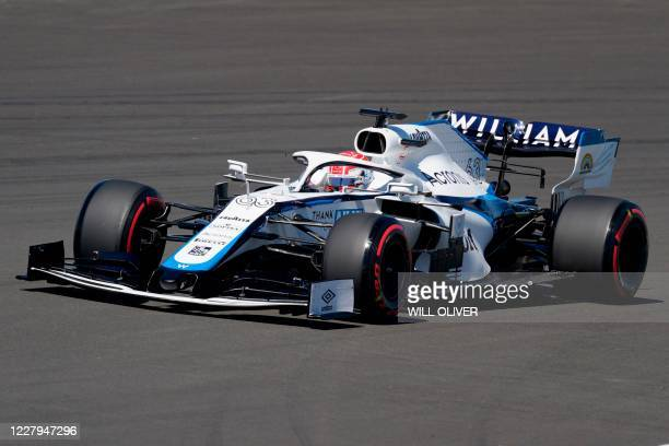 Williams' British driver George Russell steers his car during the first practice session of the F1 70th Anniversary Grand Prix at Silverstone on...