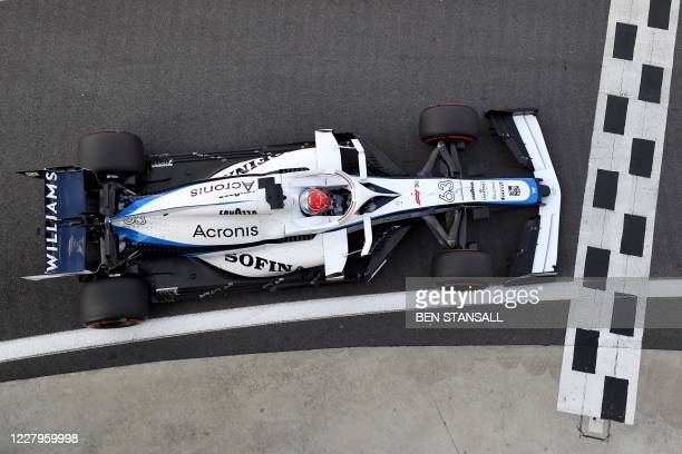 Williams' British driver George Russell steers his car during the third practice session of the F1 70th Anniversary Grand Prix at Silverstone on...