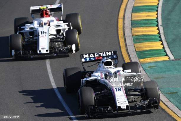 Williams' Canadian driver Lance Stroll and Sauber's Monacan driver Charles Leclerc drive around the Albert Park circuit during the second Formula One...