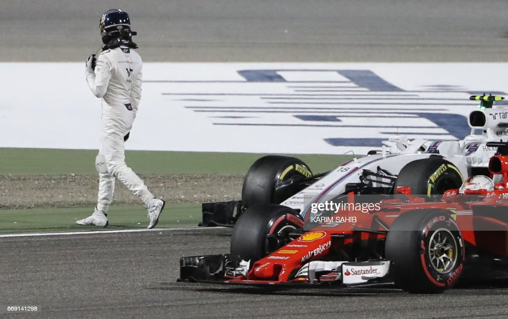 Williams' Canadian driver Lance Stroll leaves his car after colliding with Torro Rosso's Spanish driver Carlos Sainz Jr during the Bahrain Formula One Grand Prix at the Sakhir circuit in Manama on April 16, 2017. /