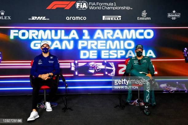 Williams' Canadian driver Nicholas Latifi and Aston Martin's German driver Sebastian Vettel give a press conference at the Circuit de Catalunya on...