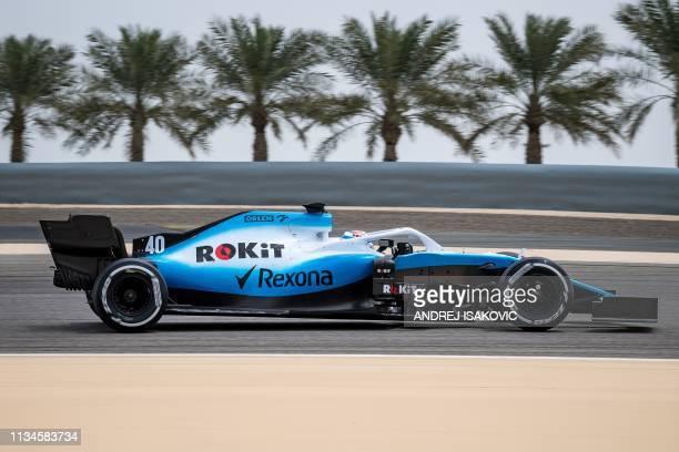 Williams' Canadian driver Nicholas Latifi steers his car during in-season tests at the Sakhir circuit in the desert south of the Bahraini capital...